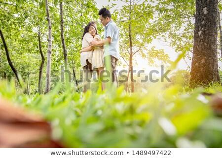 女性 · 若い女の子 · 屋外 · 笑い · 草 - ストックフォト © dolgachov