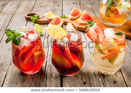 Stockfoto: Glass Of Iced Sangria With Strawberry Orange Apple And Lemon O