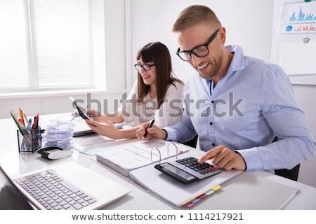 dwa · rachunek · Kalkulator · widok · z · boku · biurko - zdjęcia stock © andreypopov