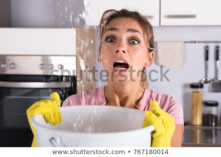 Woman Looking At Leak Ceiling Stock photo © AndreyPopov