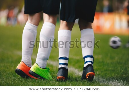 Two Soccer Football Players Standing in a Wall Stock photo © matimix