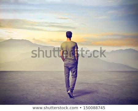 подростков мальчика горные одиночество назад небе Сток-фото © Lopolo
