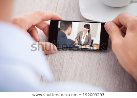 Businessperson Watching Video On Mobilephone Stock photo © AndreyPopov