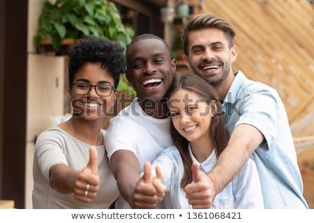Enthusiastic good-looking young happy guy, showing thumbs-up, encourage someone, praise friend did g Stock photo © benzoix