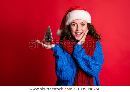 impressed woman in pullover holding to her face Stock photo © dolgachov