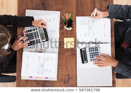 Dois empresário calculadora local de trabalho Foto stock © AndreyPopov