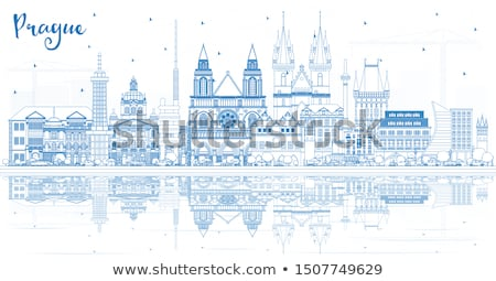 Outline Prague skyline with blue buildings and reflections. Stock photo © ShustrikS