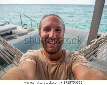 Сток-фото: человека · Мальдивы · красивый · мужчина · воды · небе