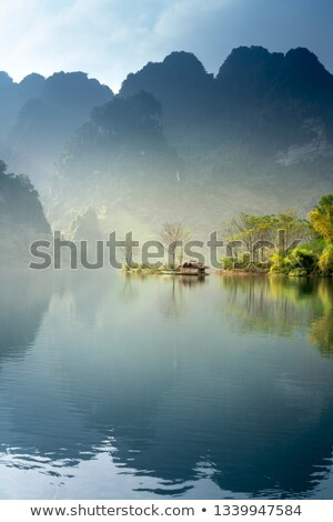 Natural landscape background with mountains, clear sky and the river flows along the forest shores Stock photo © robuart