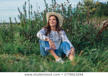girl enjoying the summer sitting on meadow stock photo © pekour