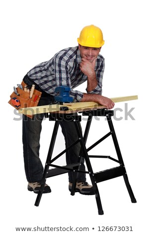 carpenter leaning on work bench stock photo © photography33