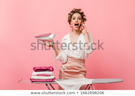 housewife irons her blouse Stock photo © ssuaphoto
