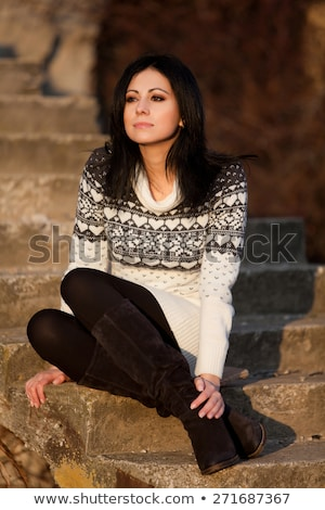 Young woman in a cream jumper and hat Stock photo © photography33