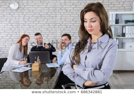 Office worker looking sadly at her laptop Stock photo © photography33