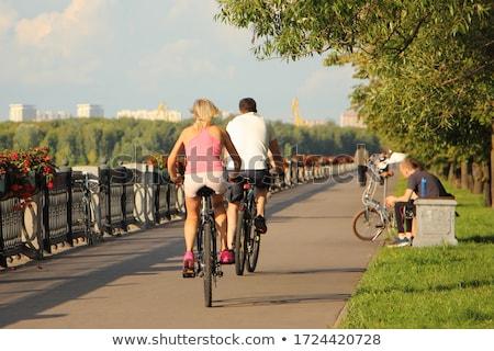 Casal ciclismo cais exercer asiático vento Foto stock © photography33