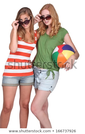Two attractive girls holding inflatable beach ball Stock photo © photography33