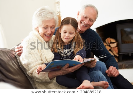 grandparent reading with granddaughter stock photo © photography33