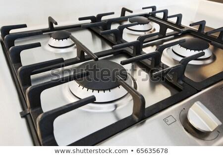 stainless steel gas hob detail on white stone worktop Stock photo © shutswis
