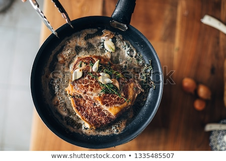 steak with crust prepared in the pan Stock photo © meinzahn