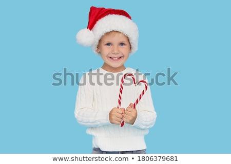 Baby santa with candy cane Stock photo © karandaev