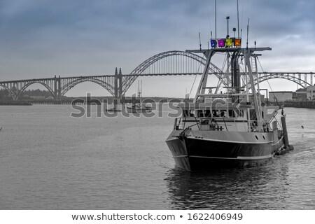 fishermen return from daily catch Stock photo © meinzahn