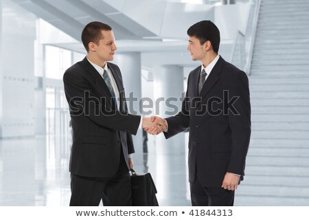 Two young businessmen greet in business centre collage Stock photo © Paha_L