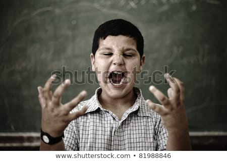 Furious mad pupil at school yelling Stock photo © zurijeta