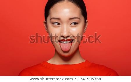 Stock fotó: Játékos · nyelv · színes · fotó · szexi · lány · visel