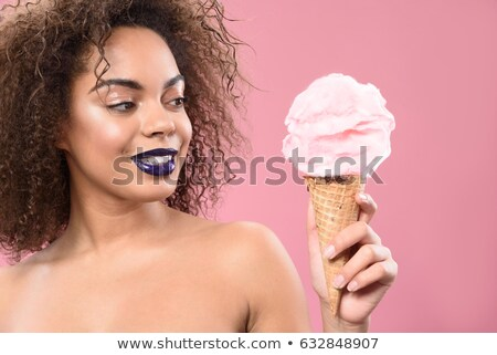 beautiful african young woman holding and posing with makeup brushes stock photo © deandrobot