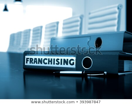 Franchising on Ring Binder. Blurred Image. Stock photo © tashatuvango