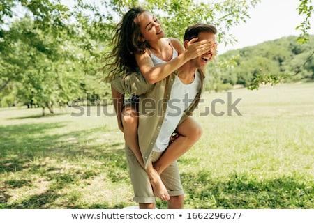 Homem mulher piggyback amor diversão sorridente Foto stock © IS2