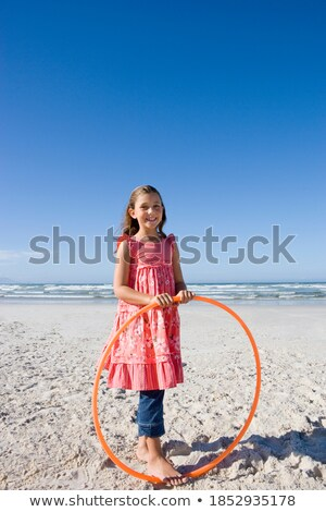 Portrait of a girl holding a plastic hoop Stock photo © IS2