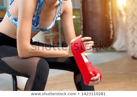 Female boxer wearing red strap on wrist Stock photo © wavebreak_media