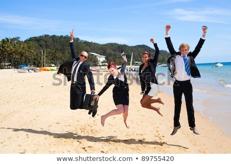 Stock photo: Group of businesspeople on the beach.