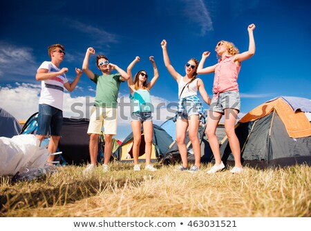 Group partying outside tents Stock photo © IS2