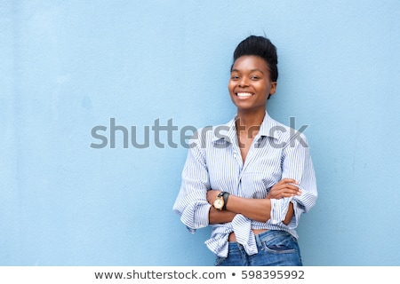 portrait of beautiful casual woman in blue shirt smiling Stock photo © feedough