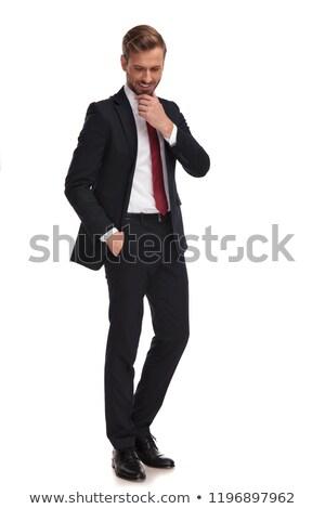 Biznesmen myślenia patrząc w dół stałego biały Zdjęcia stock © feedough