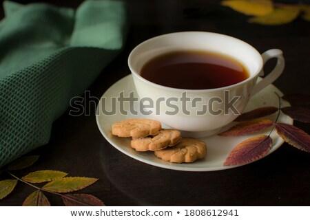 autumn yellow leaves Tea Cup cake on black background Stock photo © dmitriisimakov