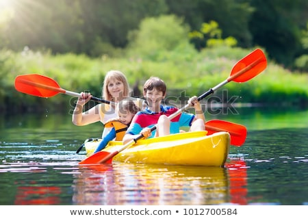 Camping kid on paddle boat Stock photo © bluering