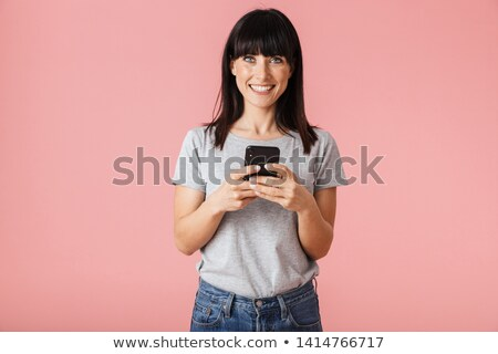 Beautiful amazing young woman posing isolated over pink wall background. Stock photo © deandrobot