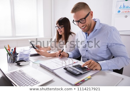 Businesspeople's Hand Calculating Invoice With Calculator Stock photo © AndreyPopov