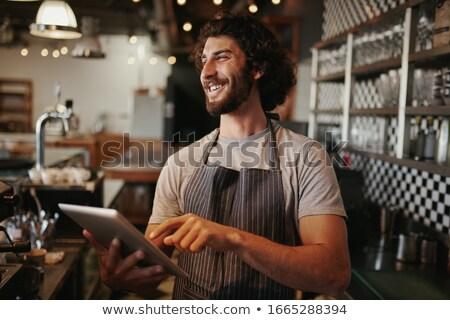 Pracodawca touchpad szczęśliwy młodych elegancki właściciel Zdjęcia stock © pressmaster