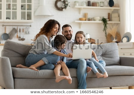 happy young father playing with little daughter on the sofa stock photo © lopolo
