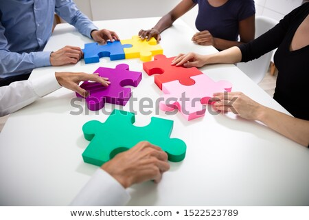 Businesspeople Building Colorful Jig Saw Puzzles Together Stock photo © AndreyPopov