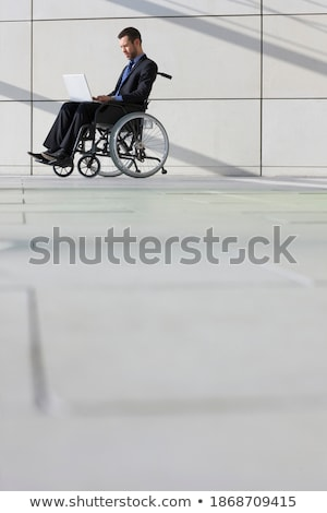 Side view of young disabled mixed race businessman using laptop during seminar in office building Stock photo © wavebreak_media
