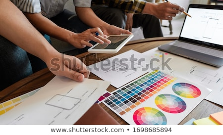 Creative team analyzing prototype products for product design in Stock photo © snowing