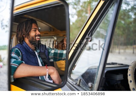 Smiling young girl with dreadlocks Stock photo © deandrobot