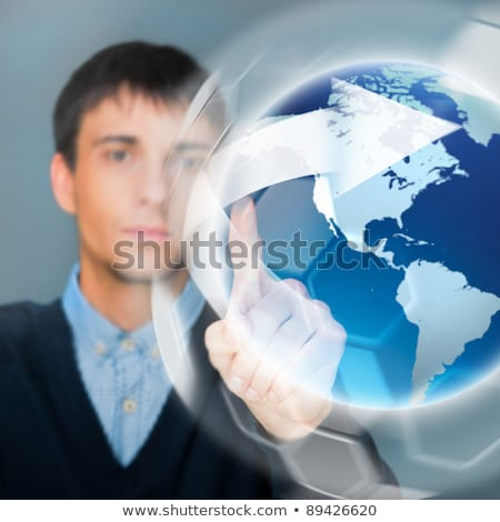 Portrait of handsome young man touching virtual globe. Global ne Stock photo © HASLOO