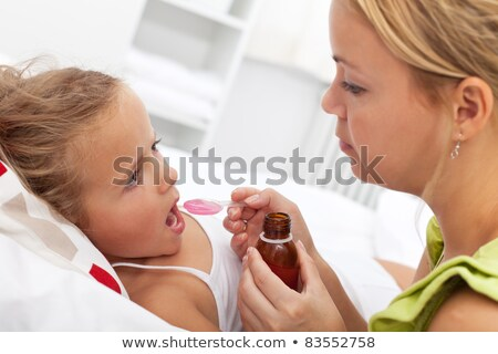 Little girl taking medicine stock photo © ilona75
