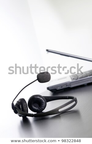 Computer and headset on the table, nothing else. Stock photo © justinb